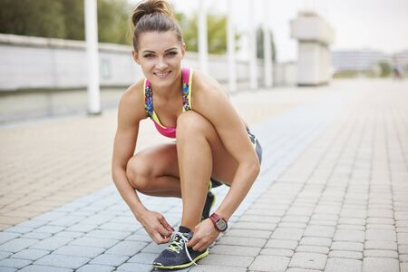 woman running: Portrait of young runner on the pavement