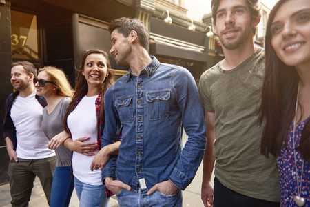 affectionate: Three couples walking across the city