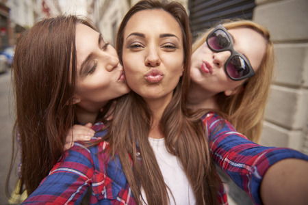 woman with camera: Three best friends taking selfie on the street