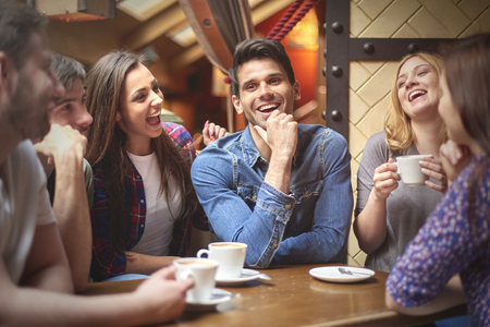 people laughing: Best friends in the coffee shop