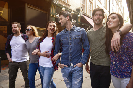 affectionate: Group of best friends touring the city Stock Photo