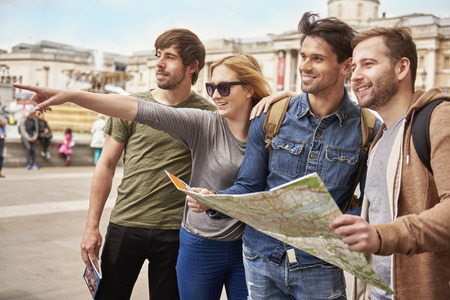 urban scene: Friends exploring the foreign city Stock Photo