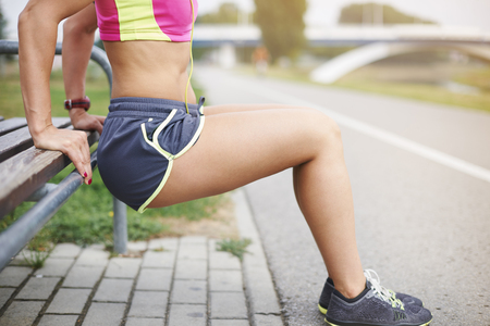 personal trainer woman: Few sit ups and different stretching exercises Stock Photo