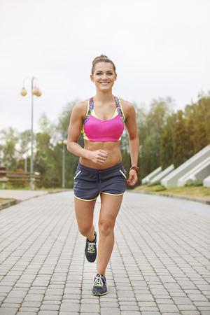 full length: Full length photo of jogging woman Stock Photo