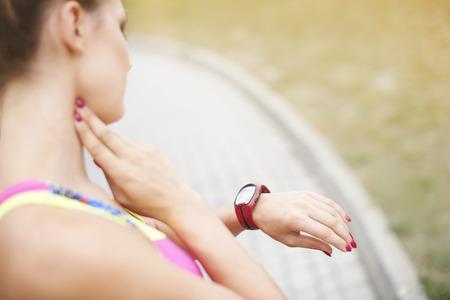 PULSE: Woman examining her pulse parometer