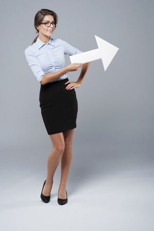 presenting: Beautiful businesswoman pointing at copy space Stock Photo