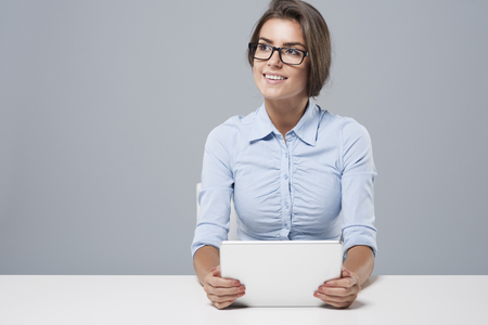 away: Business young woman using digital tablet Stock Photo