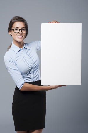 placard: Attractive woman holding a white placard