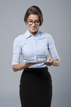 tablet: Businesswoman working by digital tablet Stock Photo
