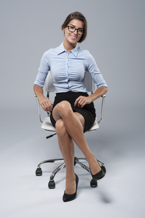 legs crossed at knee: Comfortable position of a typical white collar worker