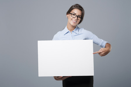 people: Shes showing on the whiteboard Stock Photo