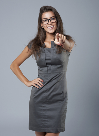 office worker: Beautiful businesswoman pointing at camera sight