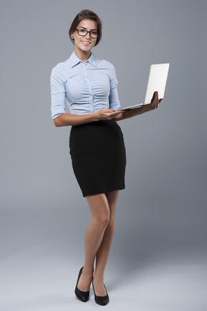 professional woman: Recent model of laptop presented by an attractive woman