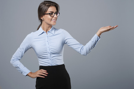 gesturing: Hand gesturing by a formal dressed woman Stock Photo