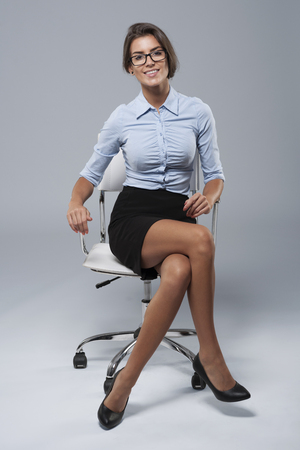Young businesswoman sitting on the chair