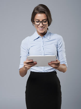 woman in office: Touch pad as a useful mobile facility
