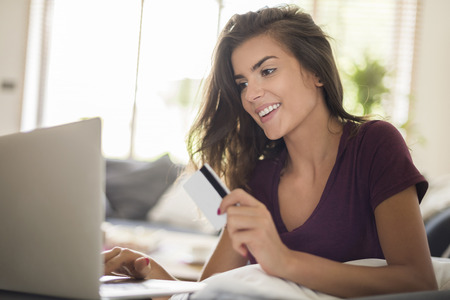 contemporary woman: Shopping online is much more easier and faster Stock Photo