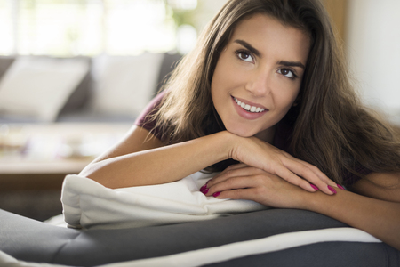 woman resting: Attractive woman resting in her living room