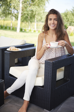 women legs: There is nothing better than coffee in the garden Stock Photo