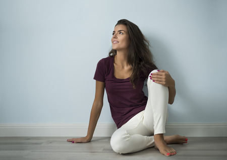 sitting on floor: Empty room and attractive woman