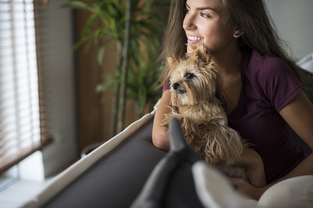 girl care: My dog is almost like a child for me Stock Photo