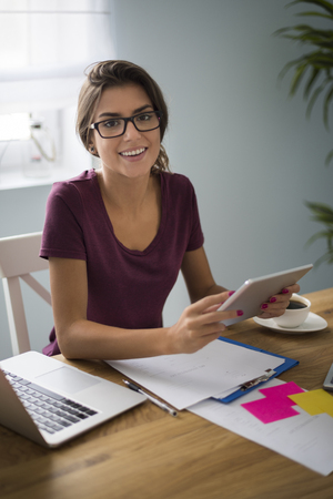 Laptop and tablet are very important at my work Stock Photo