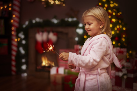 girl child: Christmas time is full of sparks Stock Photo