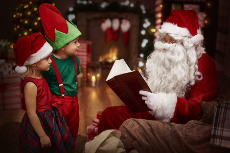 room decoration: Mysterious santa claus reading a book with children