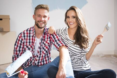 idea comfortable: Portrait of couple painting their new apartment