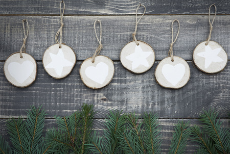 craft material: Natural christmas decoration hanging on wooden wall