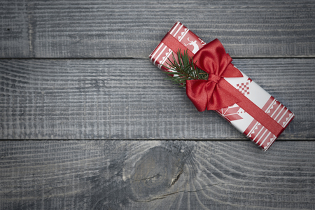 box: Beautifully wrapped gift with red ribbon