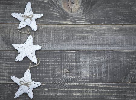 christmas stars: Christmas stars on wooden planks Stock Photo