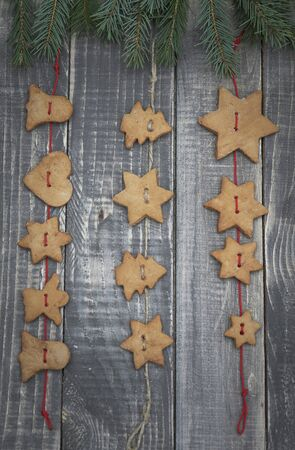 christmas tree branch: Christmas gingerbread hanging on the twine Stock Photo