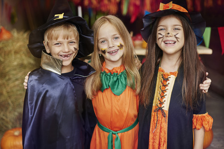 face paint: Cheerful children with Halloween face paint