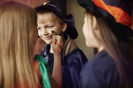 face paint: Preparation to the Halloween party Stock Photo