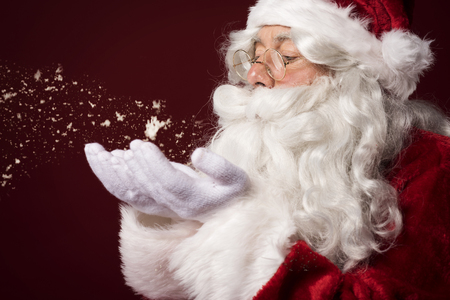 Santa claus blowing some snowflakes Stock Photo - 46806666
