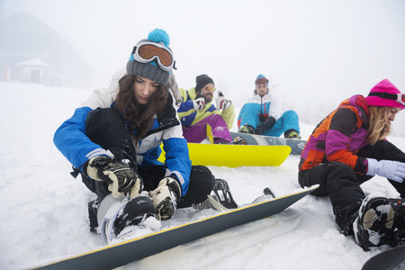 clasping: Women focused on clasping ski shoes