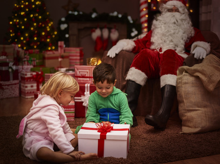 unwrapping: Abundance of presents is childs biggest dream Stock Photo