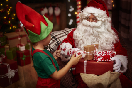 baby sitting: Little helper of St. claus at the work Stock Photo
