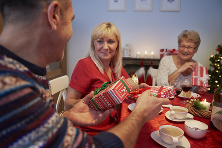 exchanging: Exchanging christmas presents during the christmas eve Stock Photo