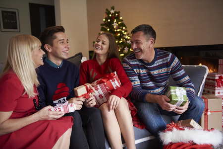 family sofa: Whole family sitting on the sofa