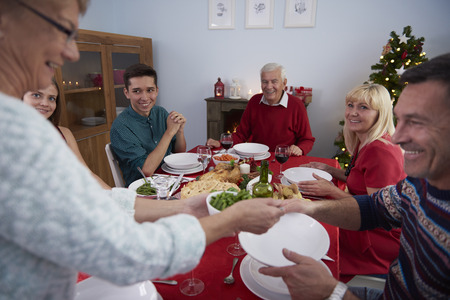 serving food: Christmas Eve in surrounding of the closest family