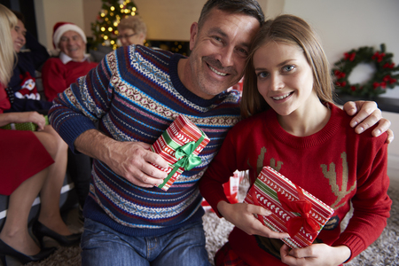 sweater girl: Portrait of cheerful father and daughter
