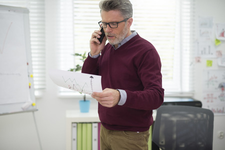 describing: Man describing the latest results Stock Photo
