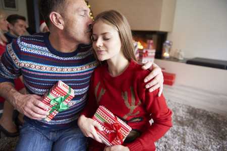 girl bonding: Father and daughter during the Christmas Stock Photo