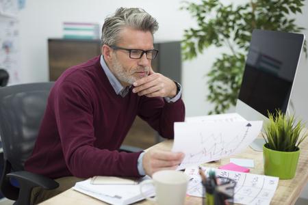 hardworking: Hardworking man reading some important documents