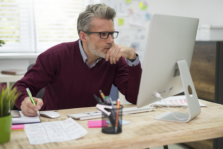 managers: Pensive man working hard on computer
