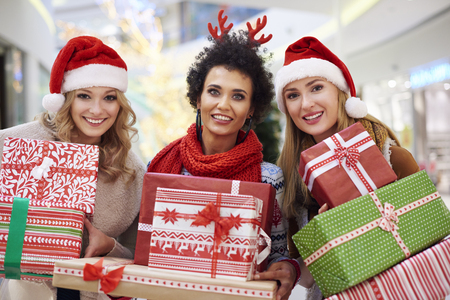 christmas gift box: Three beautiful women during the Christmas shopping