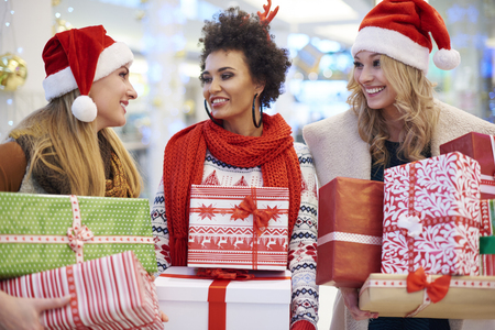 three women: Three women talking about Christmas presents