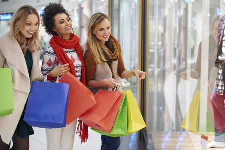 shopping scene: Three best friends during Christmas shopping Stock Photo